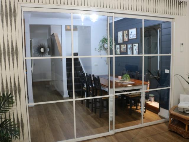white framed glass room divider