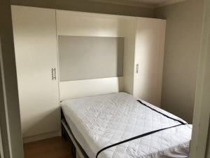 wall bed with bed open
