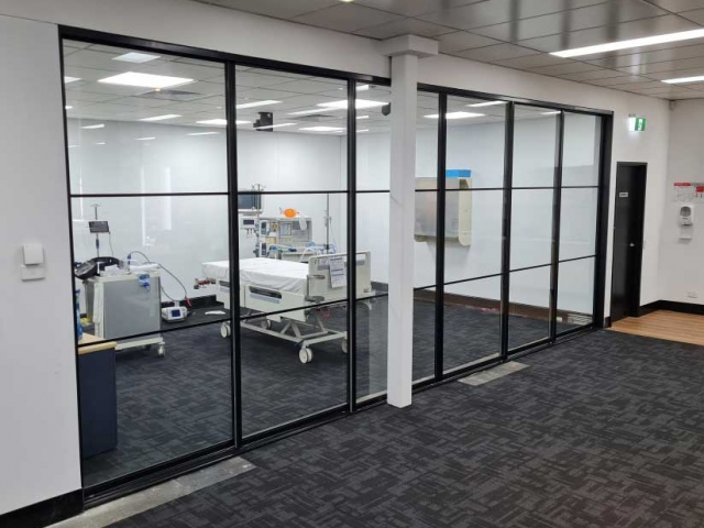 Commercial Showroom - 2 Fixed - 4 Sliding - Black Satin Hardware With Laminated Clear Glass Inserts